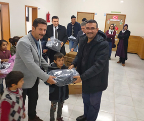 Tunay Gıda provided clothing aid with their customers to its 100 primary school students in villages where they were bought organic pomegranate.